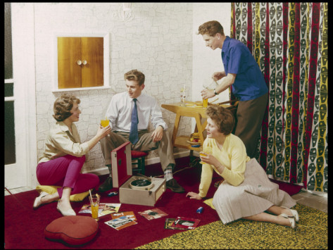 four-smartly-dressed-teenagers-having-cocktails-around-a-record-player